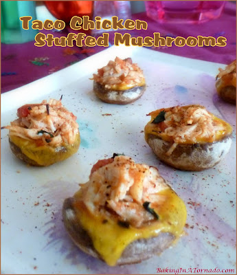 Chicken Taco Stuffed Mushrooms, a bite sized appetizer packed with chicken taco flavor. Simple to make, fun to share. | Recipe developed by www.BakingInATornado.com | #recipe #appetizer