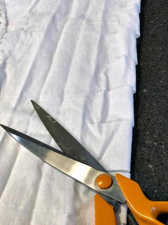 Scissors and white fabric