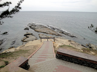 Stairs down to the furthest point possible
