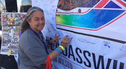 NASCAR Race Mom was honored to be able to stop by and signed the Justin Wilson  flag on display in the IndyCar Fan Village. ‪#‎BadAssWilson‬ Rest In Peace
