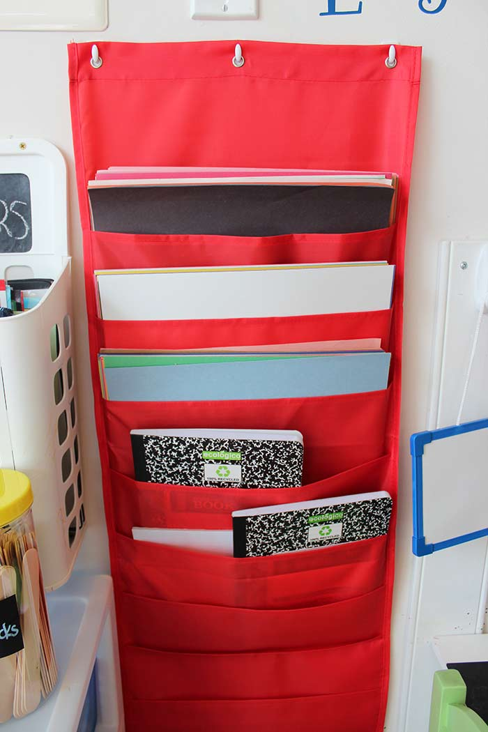 Then I Used This Awesome Hanging File Folder Pocket Chart To Store All Our  Paper And Notebooks For Doodling. I LOVE How Much Storage There Is In This  Wall ...