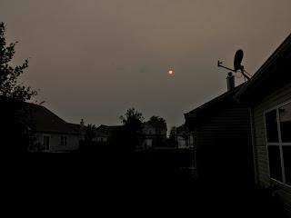 iphone photo sun through gray clouds