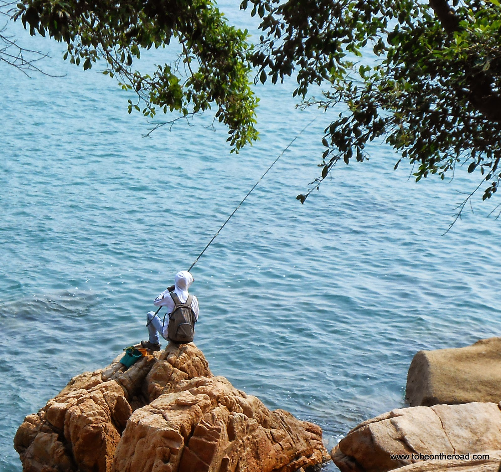 A Lonely Man Fishing In Stanley Water Front,Hongkong