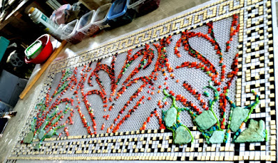 first layer of tiles of an experimental mosaic portrait of a beautiful woman's eyes. Trying to convey transparency with mosaic.
