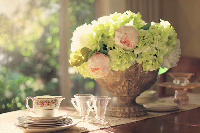 peony flowers and glasses on table