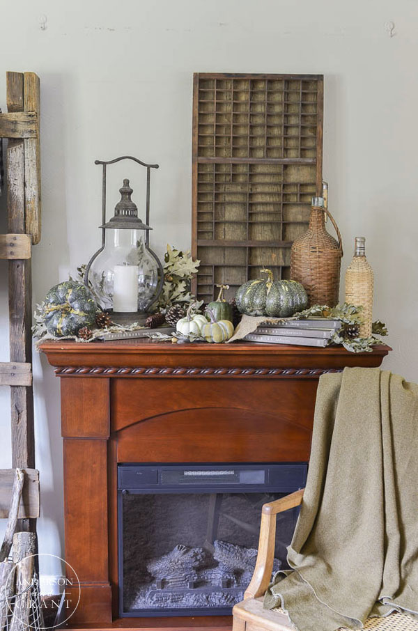 Rustic and neutral fall mantel in the living room.  ||  www.andersonandgrant.com