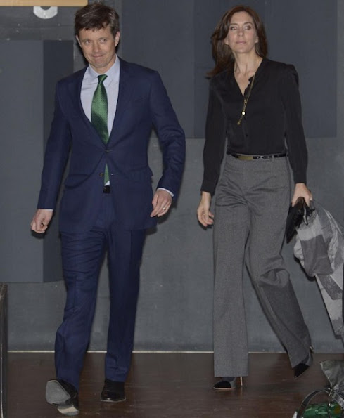 Crown Prince Frederik and Crown Princess Mary met with UN secretary Kofi Annan at Den Sorte Diamant, style wore trousers, satin top