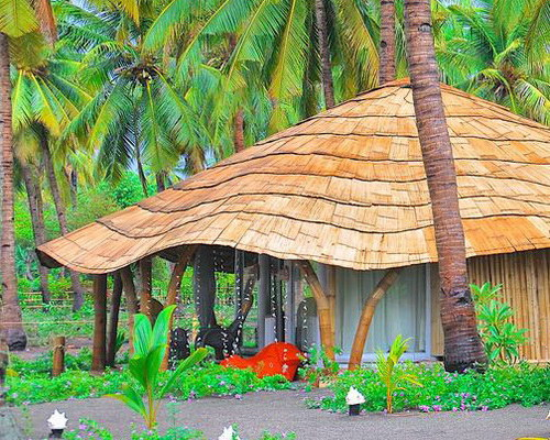 Tinuku.com Coconut Garden Beach Resort applying Sikka traditional architecture into cottages in palm trees landscape