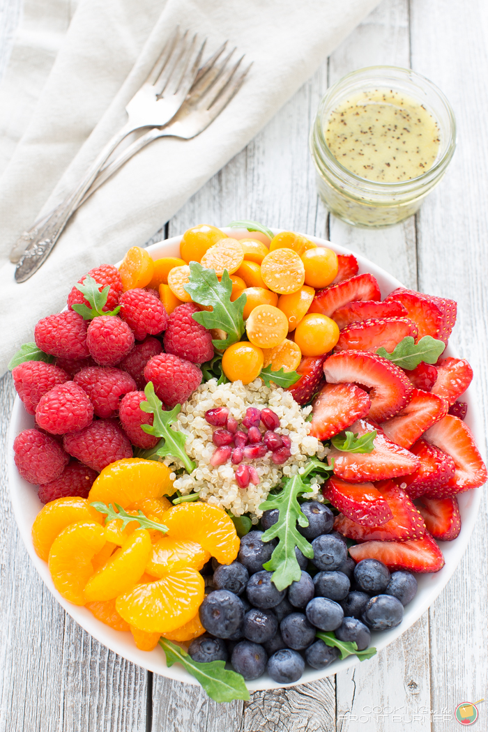 Quinoa salad with fresh berries, arugula, and orange poppy seed vinaigrette makes the perfect healthy dinner! Recipe here!