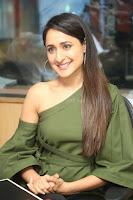 Pragya Jaiswal in a single Sleeves Off Shoulder Green Top Black Leggings promoting JJN Movie at Radio City 10.08.2017 006.JPG