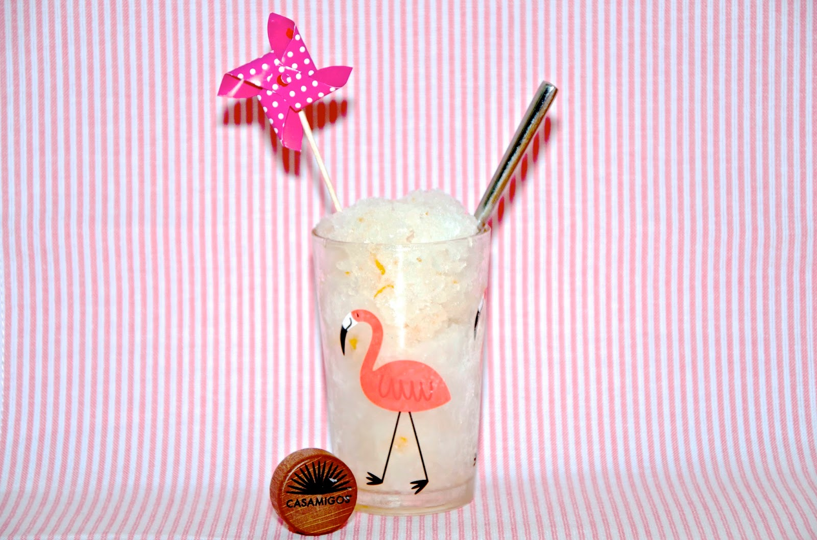 Grapefruit Tequila Granita in Flamingo Glass with Pink Striped Background
