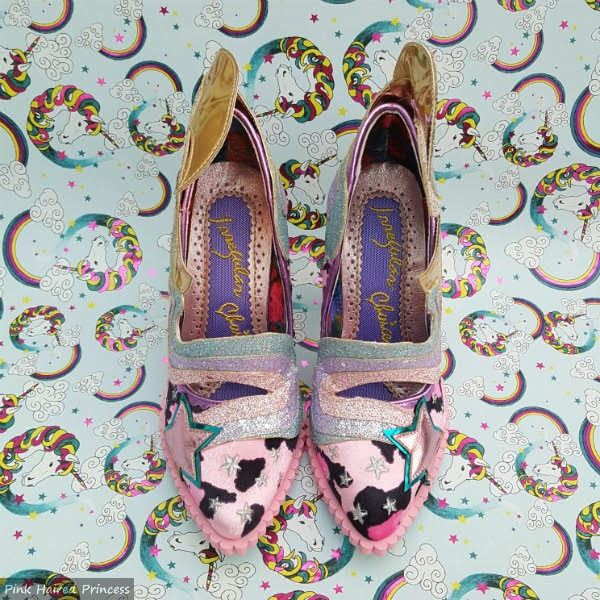 pair of shoes from above in pink leopard print with pointed toes and star detail