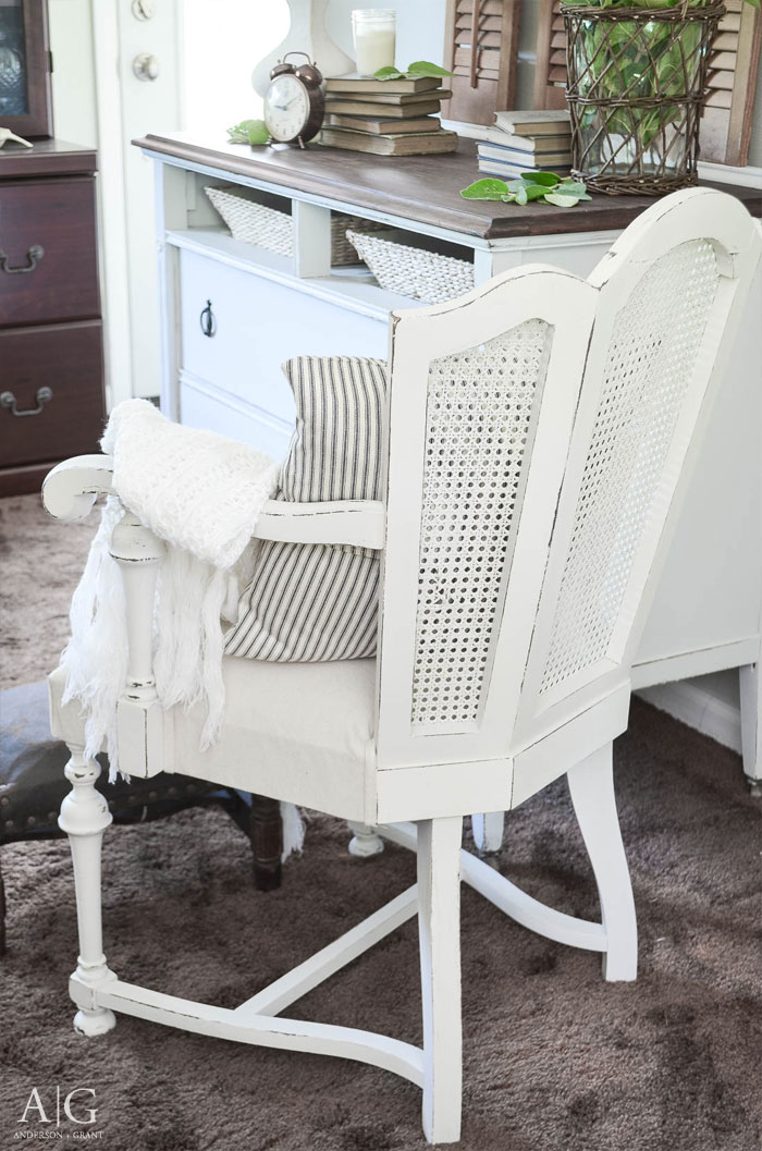 A pair of vintage cane backed chairs found at a garage sale are given a stunning farmhouse style makeover with Fusion Mineral Paint and a simple drop cloth.