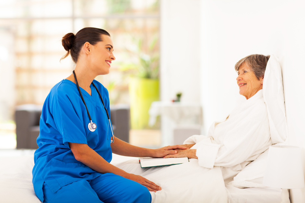 Nurse consults with her patient