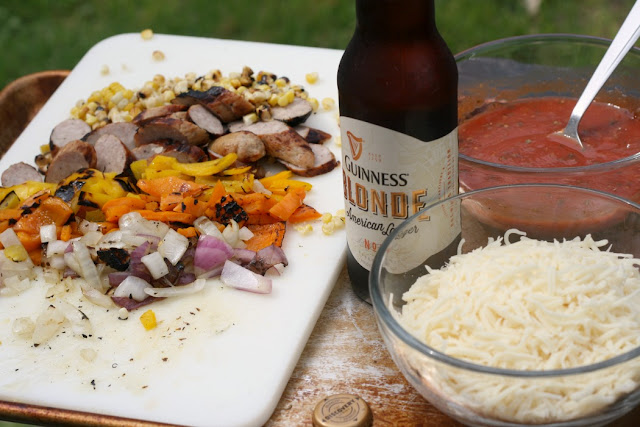 grilled onions, peppers, brats and corn for topping pizza and a Guinness Blonde