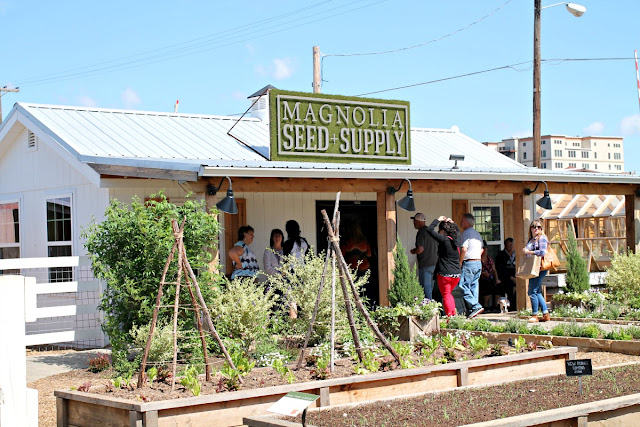 Just pass the Silos at Magnolia Market, you will find an area with raised garden beds and the Magnolia Seed & Supply store.