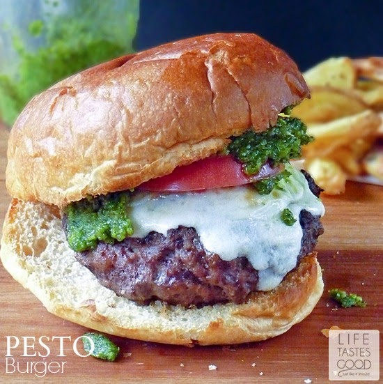 Pesto Burger Recipe | by Life Tastes Good is bursting with the classic flavor combination of basil, tomatoes, and mozzarella cheese all atop a juicy grilled burger. #Italian #Cheeseburger