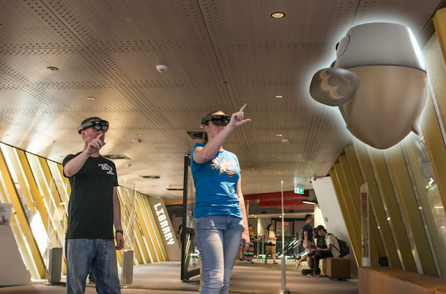 Two students in Swanston Library using HoloLens