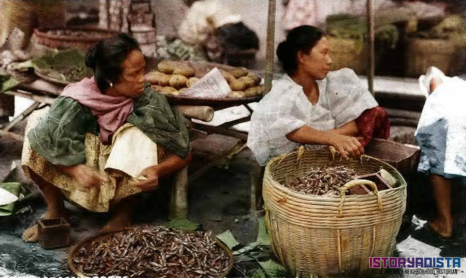 Filipino women selling dried grasshoppers (c1920s)