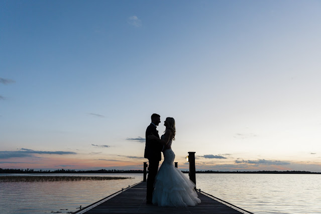 bride and groom at sunset on pier lake nona country club florida