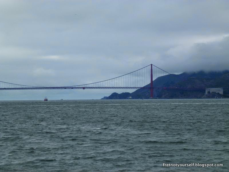 View of Golden Gate Bridge under overcast skies