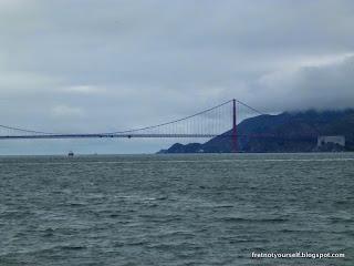 View of Golden Gate Bridge under overcast skies