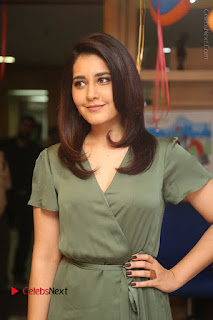 Actress Raashi Khanna Stills in Green Short Dress at Mirchi 95 Suno Aur Mercedes Jeeto Contest  0020.JPG