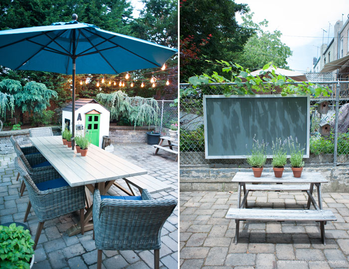 After small backyard is transformed - side by side photo of dining table with umbrella and kids picnic table with outdoor chalkboard hanging behind it