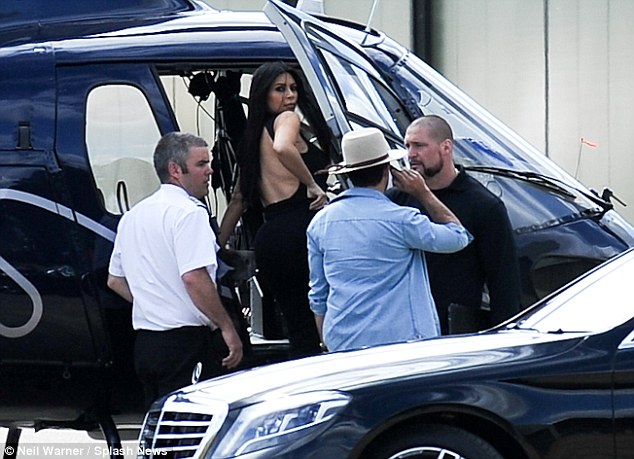 Kim Kardashian steps out braless in a semi sheer dress in London