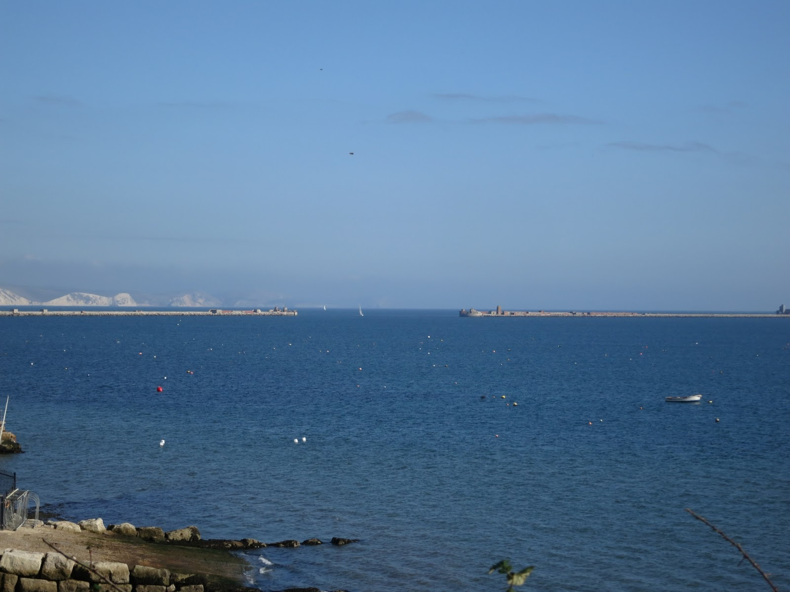 Portland Harbour, Dorset, with white cliffs of Purbeck beyond.