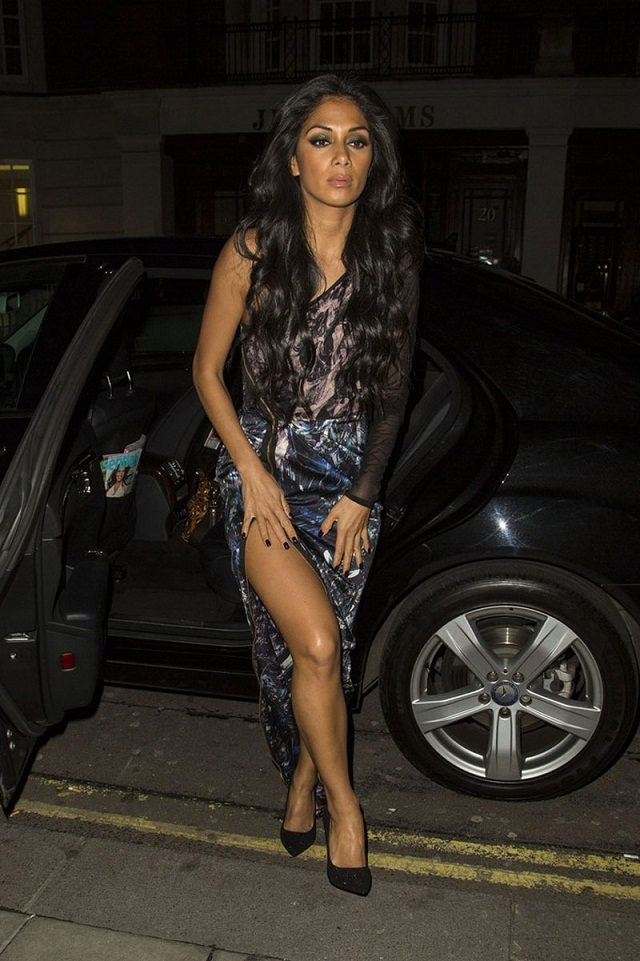Nicole Scherzinger shows off the thigh split at the X-Factor studio in London