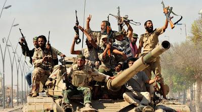 Rebeldes celebran la caída de Sirte el 20 de octubre 2011.Esam Al-FetoriReuters