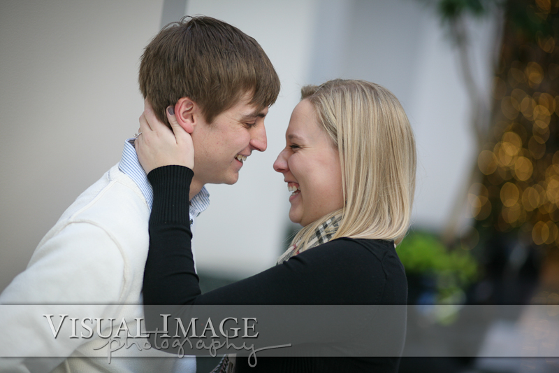 Engaged couple laughing and looking at each other