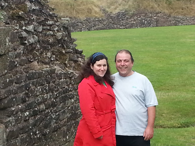 Couple Standing in Roman Amphitheatre