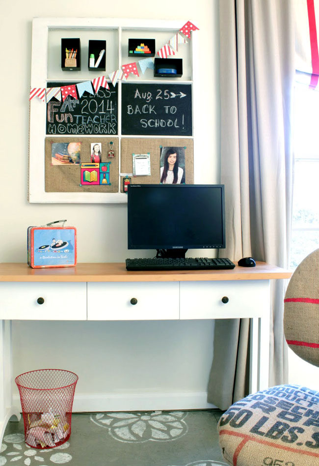 Office space in a small guest bedroom with old window board