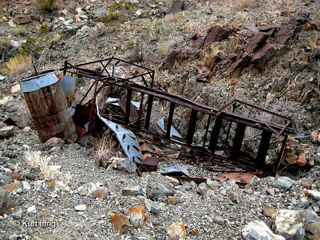 This equipment, found at the Golden Bell Mine has yet to be identified. It may have been part of a conveyor system.