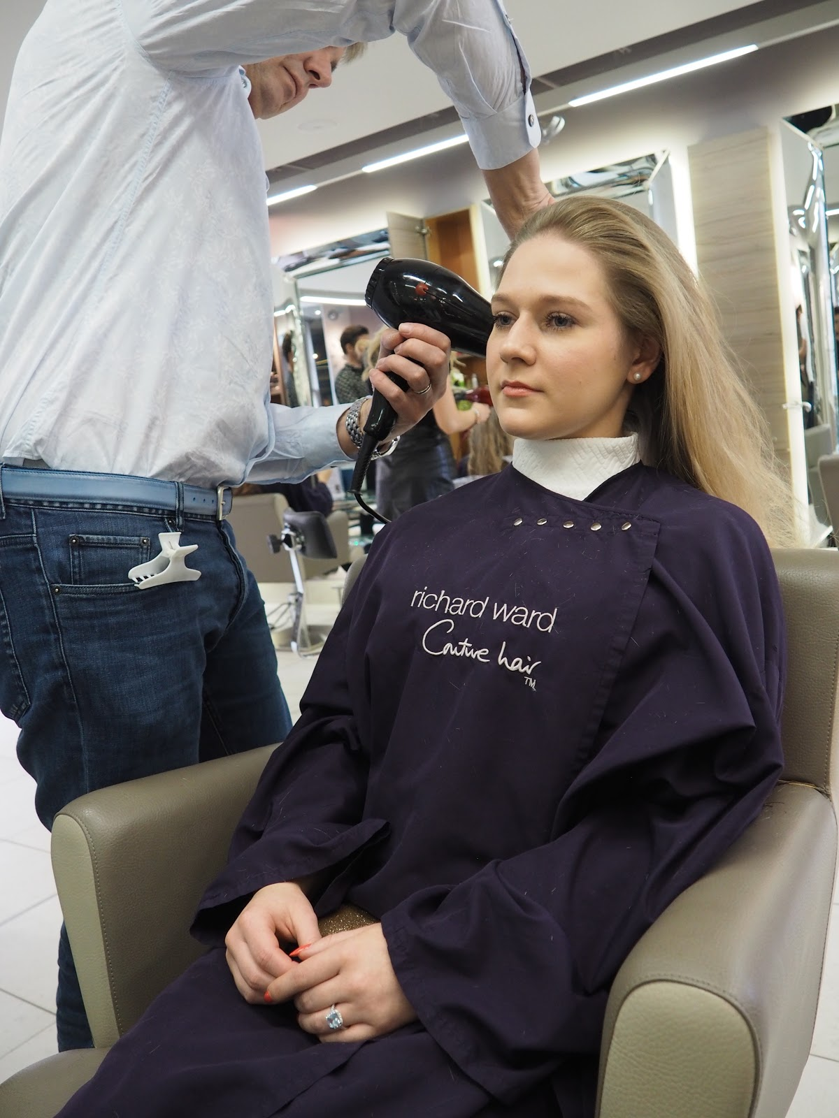 Blonde girl, Katie Matthews getting her hair blow dried by Richard Ward at the salon in Chelsea, London