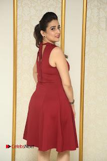 Telugu Tollywood Anchor Manjusha Pos in Red Short Dress  0028.JPG