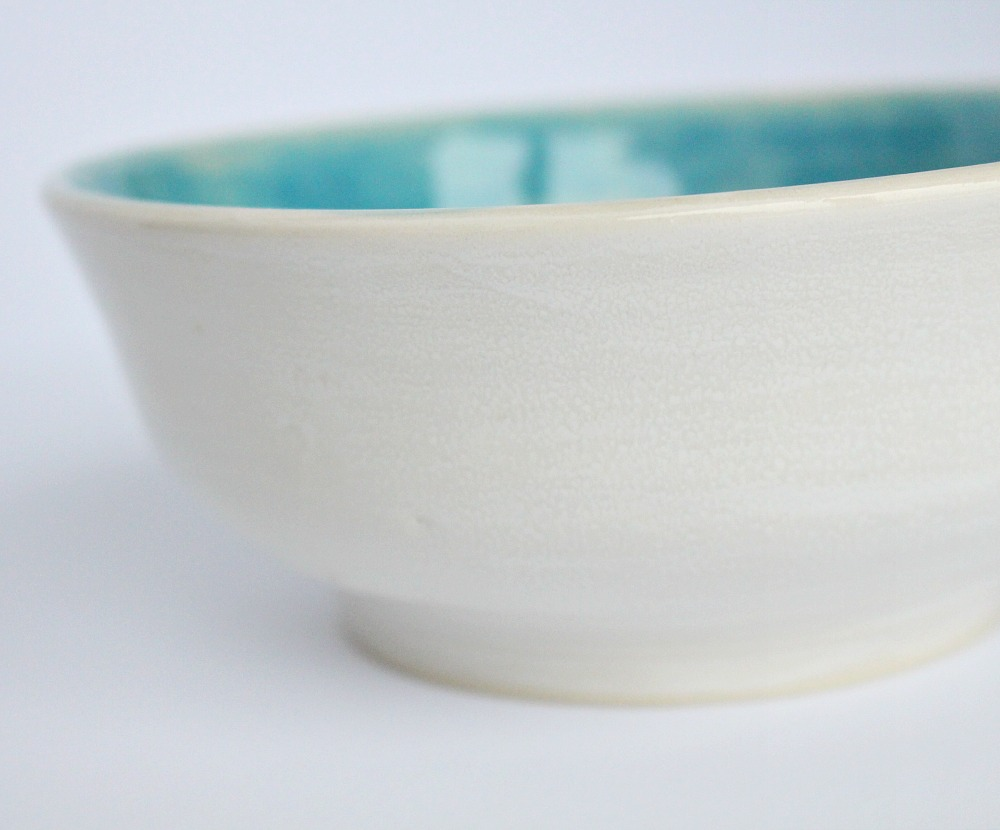 Aqua and white pottery bowl