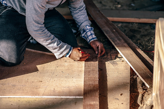 Man measure piece of wood, working, building