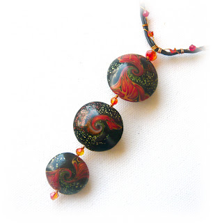 Polymer Clay Swirled Lentil Necklace combined with fire opal swarovski crystals