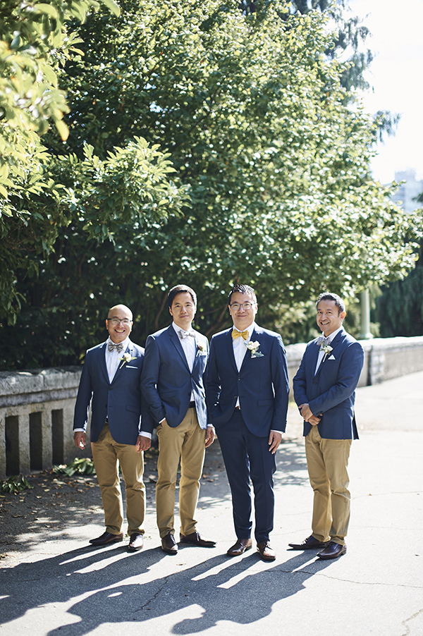 Groom in a navy suit, groomsmen in blue suit jackets and khakis