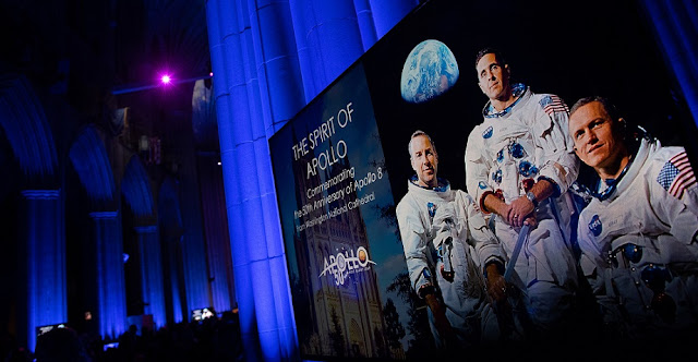 A monitor showing a portrait of the Apollo 8 crew is seen during the Smithsonian National Air and Space Museum's Spirit of Apollo event commemorating the 50th anniversary of Apollo 8, Tuesday, Dec. 11, 2018 at the Washington National Cathedral in Washington, DC. Apollo 8 was humanity's first journey to another world, taking astronauts Frank Borman, Jim Lovell, and William Anders to the Moon and back in December of 1968. Photo Credit: (NASA/Joel Kowsky)