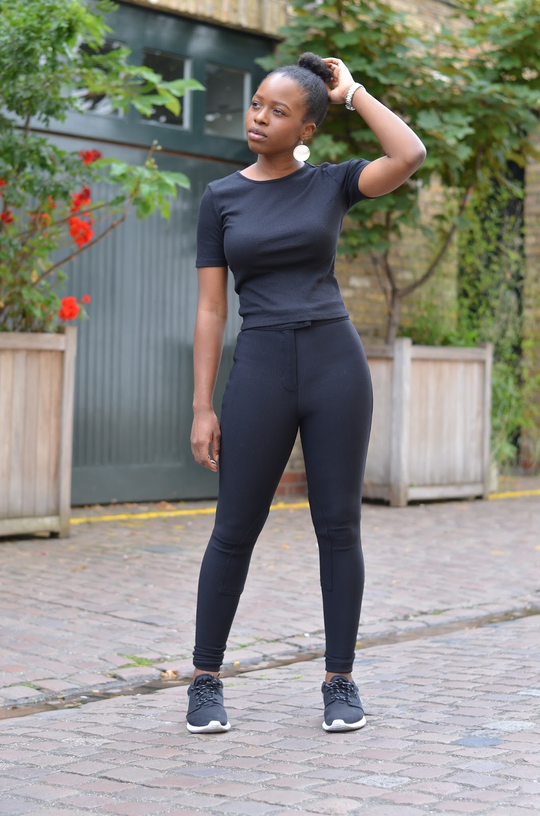 Fit Black Blogger rocking Black Riding Pants and Roshe Runs