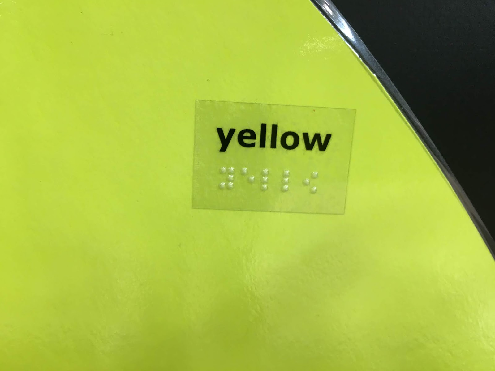 """a close up of the large eggs with braille label """"yellow"""""""