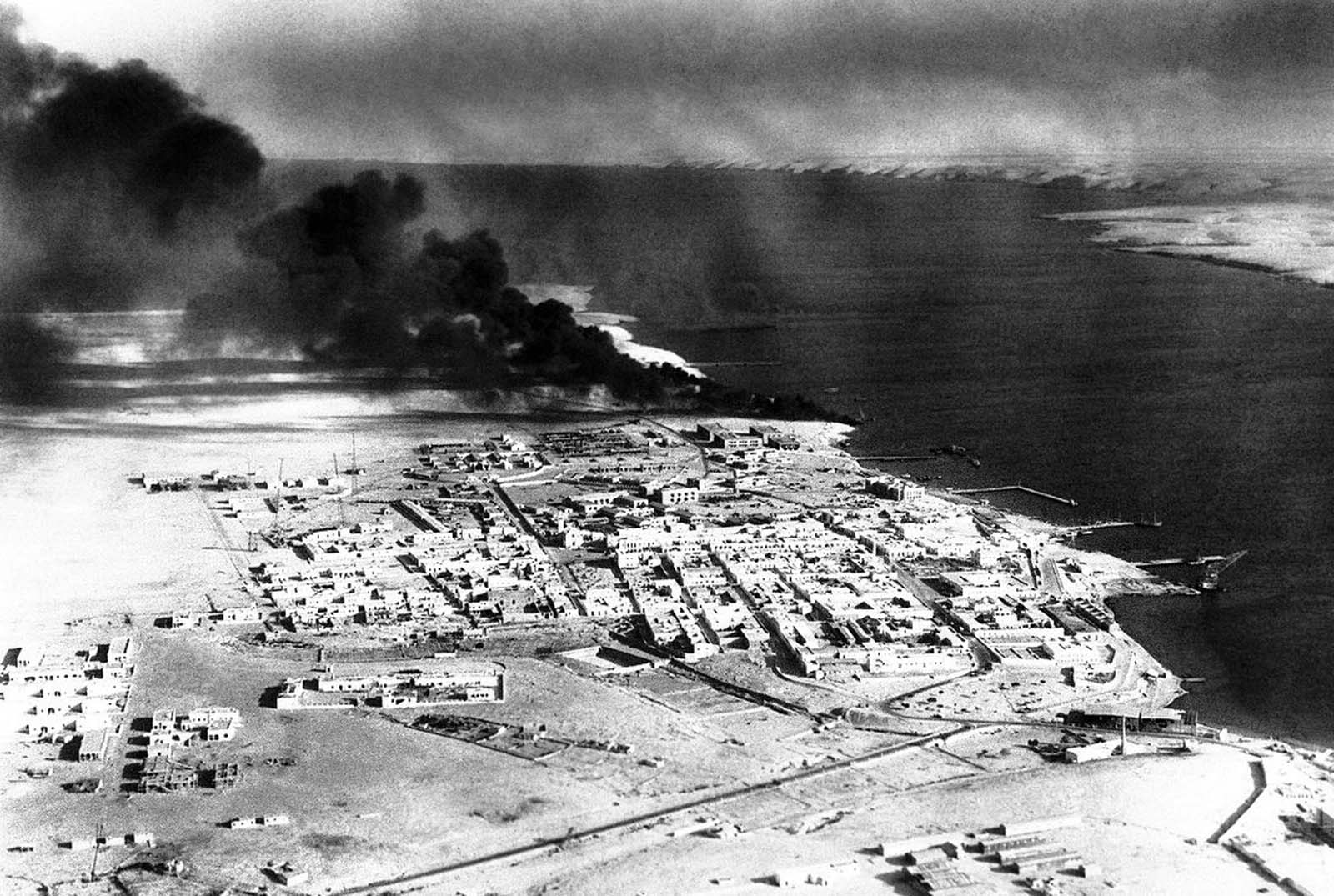 An aerial view of Tobruk, Libya, showing petrol dumps burning after attacks by Allied forces in 1941.
