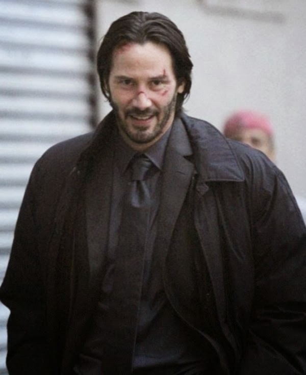 Keanu Reeves on the set - with a face that, boy