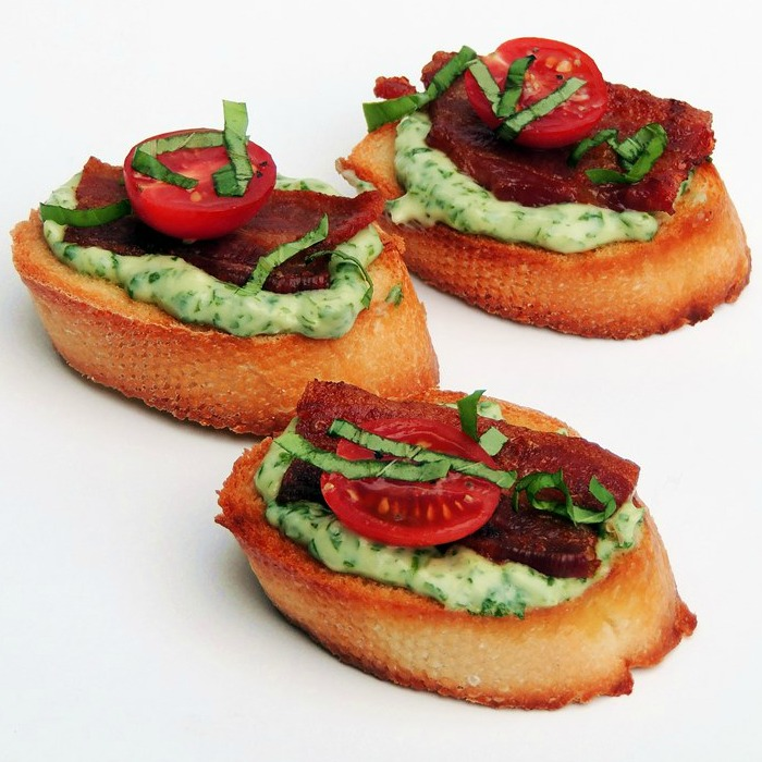 BLT Crostini with Basil Mayonnaise are the perfect bite for your next party from www.bobbiskozykitchen.com