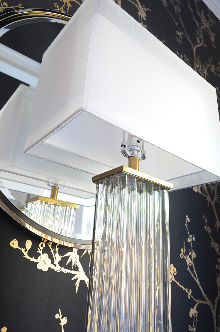 Darcia brass and crystal table lamp- looks amazing in this black, white and gold master bedroom.