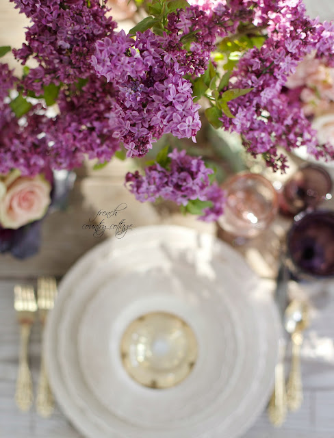 Lilacs on table with blush and gold accents